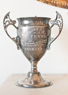 Victorian Tennis Tournament Trophy or any vintage trophy makes a great display piece for flowers (dried or fresh) moss balls or any orbs or as a stand alone with other favorite things from back in the day...