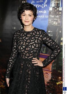 French actress sports patterned dress sans bra and a cropped hairdo.