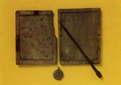 a roman wax tablet with stylus from AD100 (wax missing)