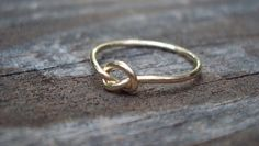 Image via We Heart It https://weheartit.com/entry/154149171/via/29738922 #jewellery #knot #love #ring #slim #tiny