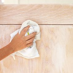 Using a clean, dry rag, work the pickling solution into the wood by rubbing against the grain. Then, using a fresh rag, wipe with the grain to remove the excess and expose the grain. Repeat this sequence, working in patches to cover the entire bench evenly. Let dry overnight. | Photo: Wendell T. Webber