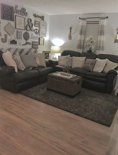Cozy, rustic, farmhouse, glam, chic, inspired living room in neutral colors, mostly greys, browns, beige, whites, & a splash of gold. My favorite, the gallery wall, cozy pillows, and leather couches make it a perfect southern family room.