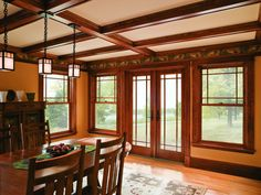 Prairie-style grilles with double-hung windows and a hinged patio door enhance the style and elegance of this dining room.