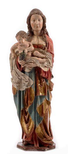 Sehr schöne gotische Traubenmadonna Höhe: 115 cm. Um 1500. Rückseitig gehöhlt. Aufrecht stehende Madonna mit reichen Gewandfalten, in beiden Armen das Kind in einem weißen faltenreichen Tuch....