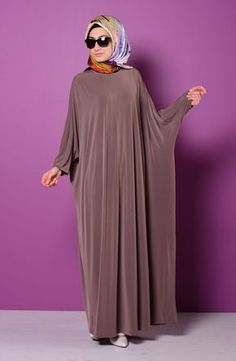 Bat Sleeve Abaya Colors: Black, Green, Dark Blue, Red, Tan and Plum. Available Sizes: XSmall, Small, Medium, Large, and XLarge. Material: Polyester, Jersey and Lycra. Abaya is unlined. Very comfortabl                                                                                                                                                                                 More