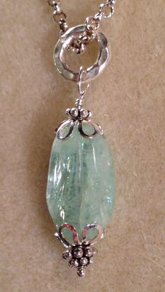 Sterling silver necklace with Aquamarine stone $40