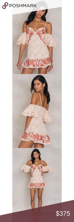 For Love & Lemons Matador Tank Dress Features thin adjustable straps with a cold shoulder design complete with frilled sleeves with elastic bands at the arm, a sweetheart neckline, a beautiful pink floral lace design, floral embroidery in a complementary darker pink hue, a rounded hemline at bottom, a subtle back zipper with a hook and eye closure, and is fully lined. Materials: Shell: 50.5% Nylon, 49.5% Cotton. Lining: 93% Polyester, 7% Spandex. The product is true to size. Color: pink For…