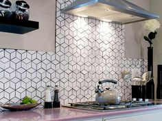 Geometric Backsplash..just a combination of identical triangles placed at different angles...I could totally recreate this with white paint and a black sharpie paint pen and a diamond/parallelogram to trace