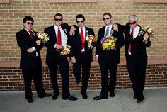 Groomsmen posing with bouquets | Funny wedding photos | Matt Mason Photography | Lake Geneva, WI