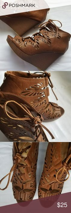 Laser Cut Out Lace Up Platform Heels Brown 12M Jasmine Katrina Laser Cut Out Lace Up Open Toe 12M Color Wood Brown Geometric shapes smartly design this comfortable peep-toe bootie platform heeled wedge. Wear the novel lace-up wedge with trousers to incorporate an airy style at work. Excellent Pre-owned Condition. jasmin Shoes Wedges