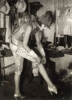 Preparing for the matinee, 1928. Is that a 1920s version of an equestrian's hard…