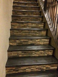 Home Remodeling Nice idea for the stairs . tiled with wooden treads. I'm in love with these tiled stairs! - Tile is a popular material for covering various parts of the house such as floors, walls, and stairs.