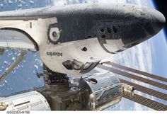 STS-132, May 17, 2010  Space shuttle Atlantis, docked to the International Space Station, is featured in this image photographed by an STS-132 spacewalker during the mission's first session of extravehicular activity (EVA).