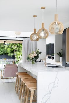 Stools from MRD Home; pendant lights from Beacon