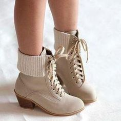 Simple, classic boot-like frame with the heel and the laces all put together with a cream color material. Cute!