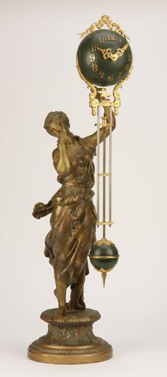 Late 19th century French gilt metal figural swinger clock in the form of a maiden holding aloft an oversized sphere shaped clock with attached pendulum.
