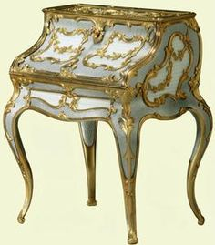 Miniature desk 1896-1908, Carl Fabergé. Acquired by Queen Elizabeth The Queen Mother. Originally purchased from the London branch on 12 July 1909 by Leopold de Rothschild, a connoisseur of Fabergé and friend of King Edward VII. The purchase price was high – £150 15s – reflecting the complexity of the desk's production. The desk formed part of Queen Elizabeth's collection for many years, having been purchased by King George VI from the firm of Wartski for £375 on 2 February 1946.