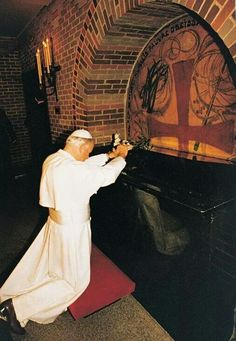 Pope John Paul II praying at the tomb of St. Andre Bessette - St. Joseph's Oratory, Montreal.........