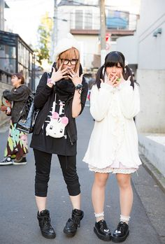 We met Makoto and Ayumu – both students – on the street in Harajuku.Makoto is the one in white, with black hair in twin tails. She is 17 and she's wea...