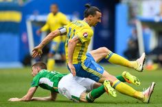 Sweden's forward Zlatan Ibrahimovic (top) falls over Ireland's midfielder James McCarthy during the Euro 2016 group E football match between Ireland and Sweden at the Stade de France stadium in Saint-Denis on June 13, 2016. / AFP / MARTIN BUREAU