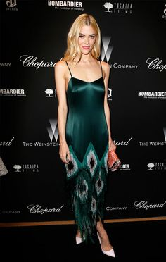 Make a statement (it's the one night of the year you can go all out) and in a gem-tone peacock inspired slip dress like Jaime King