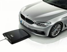 BMW Wireless Charging Station, a fully integrated inductive charging facility for the high-voltage battery, that works like wireless chargers for gadgets. Wireless Charging Pad, Hybrids And Electric Cars, Automobile, Inductive Charging, Bmw S, Sport Seats, Mens Gear, Male Magazine, Tecnologia