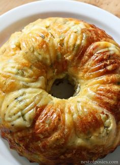 Mexican Bubble Bread...with cheese and green chilies is delicious! 2 12 oz cans of refrigerated Biscuits tubes - cut in quarters 1 1/2 cup of Mexican Cheese 1 1/2 cup of Mozzarella Cheese 1 stick of butter melted 1 4.5 oz can of chopped Green Chilies 1 1/2 teaspoon of dried parsley chopped cilantro - optional jar of jalapenos - optional