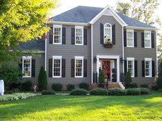 Red Door Grey House exterior color inspiration- grey siding, navy? shutters, red door