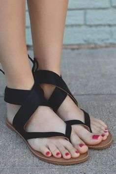 This unique pair of sandals is the ideal finishing touch to all of your festival wear this season! Our Eyes On Me Sandals are a pair of vegan leather, ankle wrap, flat sandals with a self tie back. *A