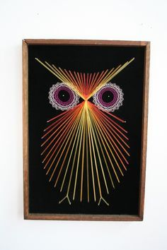 Vividly colored string art owl on black velvet. Measures 18.75 by 12.75. Comes wired and ready to hang. The wooden frame is coming apart ever so slightly in the top lefthand corner. Otherwise in excellent condition.