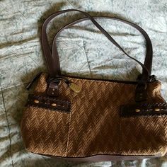 Crazy House shoulder purse This purse has two pockets outside and two pockets inside along with one zipper pocket inside Crazy Horse Bags Shoulder Bags
