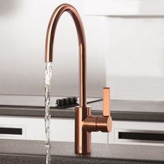 This modern style kitchen mixer tap adds a stunning unique style twist from the traditional gold finish.
