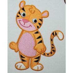 "Baby Safari Tiger    Embroider this tiger on a baby romper, onesie, baby bib, quilted blanket or decorate a nursery.  This design is part of a Combo: Baby Safari Friends anf Soft Toy Combo    You receive:  2 Designs (1 unique design in 2 hoop sizes)  Available Size  4"" x 4"" (100mm x 100mm) Hoop, 5"" x 7"" (130mm x 180mm) Hoop"