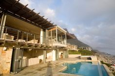 Villa Misty Cliffs is an exquisite three-bedroom situated right on the beach at Misty Cliffs. Table Mountain, Weekends Away, Cape Town, Cliff, National Parks, Coast, Villa, Mansions, Architecture