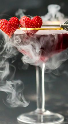 Love Potion #9 ~ Triple Berry Martini tastes great, is beautiful, and EASY... Made with dry ice, this is such a fun and festive Valentines Day pink drink!