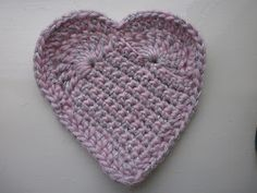 Heart. I need a elbow patch for a sweater...this might do it. Pattern, in Dutch, here http://karinaandehaak.blogspot.com/2011/11/patroon-gehaakt-hartje.html