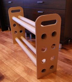 This is a very effective use of cardboard. The simplistic design gives it a purpose and the common sense idea of using more holes on cardboard to add extra tubes in the future is a very interesting concept. The use of tubes is giving the use of cardboard an extra dimensional purpose, when normally triangles are used for strength.