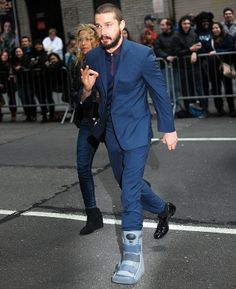 Shia LaBeouf scrubs up well as he hobbles to Letterman studios on injured ankle