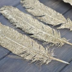 Decorate your home for the holidays with these beautiful DIY Gold Glittered Feathers!