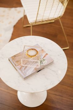 Marble coffee table with coaster and book