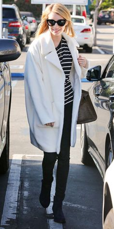 Emma's crisp white style is unexpected and dresses up a casual-cool daytime look: skinnies, a striped tee and classic cat-eye sunnies (dec 2014)