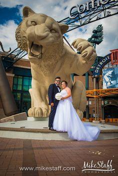 Smiling bride and groom at Comerica Park  #Michiganwedding #Chicagowedding #MikeStaffProductions #wedding #reception #weddingphotography #weddingdj #weddingvideography #wedding #photos #wedding #pictures #ideas #planning #DJ #photography #bride #groom