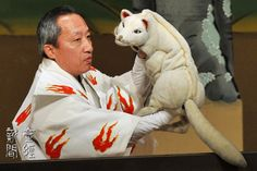 """Bunraku production of """"Yoshitsune and the thousand cherry trees"""". Check out the puppeteer's fox fire kimono!"""