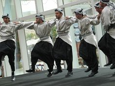 "Dabke(Arabic: دبكة‎); also written as ""dabka"",""dabki"", ""dabkeh"", ""debke"", ""debkah"", ""debki"", ""debka"" is a modern Levantine Arab folk dance of possible Canaaniteor Phoenician origin.   It is popular in Palestine, Lebanon, Jordan, Turkey, and Syria. A line dance, it is widely performed at weddings and joyous occasions. The line forms from right to left. The leader of the dabke heads the line, alternating between facing the audience and the other dancers. Source…"
