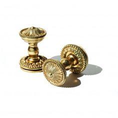 A+pair+of+gilt+brass+door+knobs,