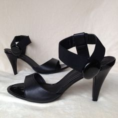 Satrapy Sandals by Kelly&Katie size 9.5 Super stylish with patented over sized button with no slip sole we'll made heels size 9.5 Kelly & Katie Shoes Heels