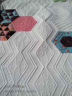 Oh my word! I love the texture my (judi madsen) quilting made on this hexie quilt!  So beautiful!