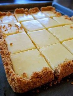 CREAMY LEMON SQUARES: FOR THE CRUST 4 tablespoons butter, melted and cooled, plus more for pan cup graham cracker crumbs ¼ cup sugar FOR THE FILLING 2 large egg yolks 1 can ounces) sweetened condensed milk ½ cup fresh lemon juice lemons) How 13 Desserts, Dessert Recipes, Paleo Dessert, Easy Lemon Desserts, Key Lime Desserts, Dessert Food, Party Desserts, Fruit Recipes, Dessert Ideas
