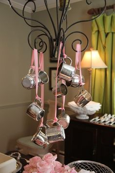 Hang silver-plated (cheaper than real silver) baby cups from a chandelier at a baby shower