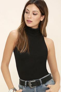 ec1b92d95806 Feel free and feisty in the Alive and Kicking Black Sleeveless Turtleneck  Top! Soft black